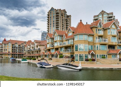 KELOWNA, BRITISH COLUMBIA, CANADA - JUNE 2018: The apartments in the Sunset Waterfront resort in Kelowna, British Columbia, Canada, have moorings for boats.