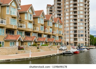 KELOWNA, BRITISH COLUMBIA, CANADA - JUNE 2018: The apartments in the Sunset Waterfront resort in Kelowna, British Columbia, Canada, have moorings for boats.