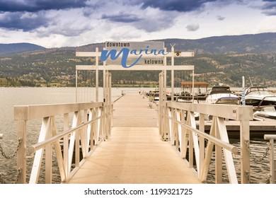 KELOWNA, BRITISH COLUMBIA, CANADA - JUNE 2018: Entrance to the jetty in the marina in Kelowna, British Columbia, Canada.