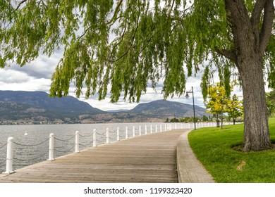 KELOWNA, BRITISH COLUMBIA, CANADA - JUNE 2018: Wooden walkway around the edge of Okanagan Lake in Kelowna, British Columbia, Canada.