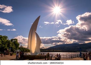 Kelowna, British Columbia/Canada - July 24, 2020: Sunset over the iconic fiberglass sculpture 'Spirit of Sail' at the City Park of Kelowna at the bottom of Bernard Avenue