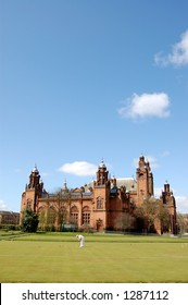 Kelvingrove Art Gallery with man playing croquet in foreground