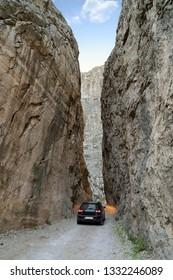 Kemaliye, Turkey - October 2018: A car driving through stone road in Kemaliye Egin town of Erzincan, Turkey