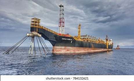 KEMAMAN, MALAYSIA - DECEMBER, 23, 2017: A LNG tanker anchored at anchorage area in Kemaman Supply Base. LNG stand for liquified Natural Gas.