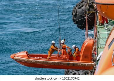 Kemaman Supply Base, Terengganu - May 19, 2017: Marine crews of a pipelay barge performing man overboard emergency rescue drill at Kemaman Port Anchorage