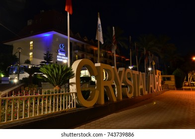 KEMER, ANTALYA, TURKEY - OCTOBER 2, 2017: Main entrance of Crystal Aura Resort Beach & SPA hotel, long exposure shot from Ataturk boulevard.