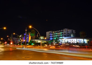 KEMER, ANTALYA, TURKEY - OCTOBER 2, 2017: Shopping center and Palmet Resort & SPA, long exposure shot through Ataturk boulevard.