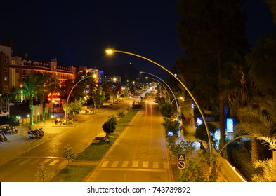 KEMER, ANTALYA, TURKEY - OCTOBER 2, 2017: Long exposure shot of Ataturk Boulevard, center of Kemer and the mountain with a flag from pedestrian bridge.