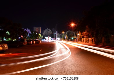 KEMER, ANTALYA, TURKEY - SEPTEMBER 26, 2017: Long exposure  car light trails at Sehit Polis Cemal Ilgaz Caddesi, street near Kugulu park, Grand Haber hotel and Hydros Club hotel.