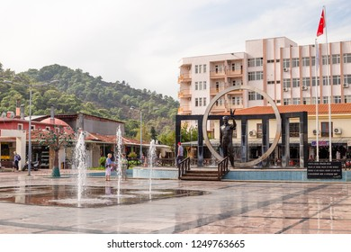 KEMER, TURKEY - OCT, 2018: Central square in of Kemer, Turkey. Fountains and tourists walking, famous place, urban landscape.