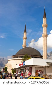KEMER, TURKEY - OCT, 2018: Mosque in Kemer, Turkey. Religious building, Muslim, city street, mountains on background.