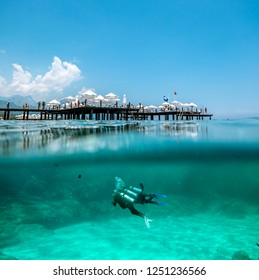 Kemer. Turkey.June 7, 2018.View of the coast and the beach in Kemer over water and under water .