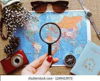 Kemerovo, Russia, 05/12/2018, Top View of a map and items, Planning a trip or adventure. dollars money background.Financial concept.Travel planning dreams. Map of the world.Travel concept background.