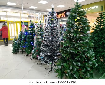 KEMEROVO, RUSSIA, DECEMBER 09, 2018. Christmas sale of artificial fir trees in the lobby of the shopping center Laplandia