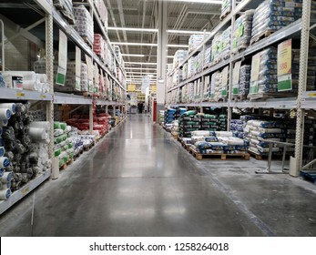 KEMEROVO, RUSSIA – DECEMBER 10, 2018. Aisle among shelvings with packages of building materials in a large store Leroy Merlin