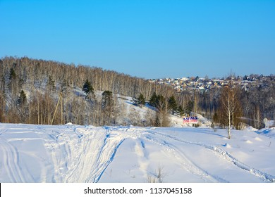 """Kemerovo, Russia- February 11, 2018: The area of mount Luskus, snowmobile track and view of the village of garden association """" Energetik"""", Kemerovo, Russia"""