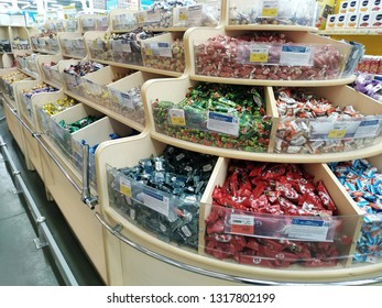 KEMEROVO, RUSSIA, FEBRUARY 14, 2019. A lot of  various candies are sold in a hypermarket Lenta