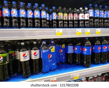 KEMEROVO, RUSSIA, FEBRUARY 14, 2019. Plastic bottles of Pepsi Cola on the shelves are sold in a hypermarket Lenta