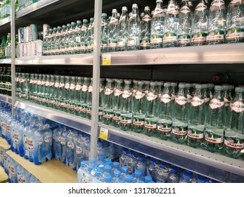 KEMEROVO, RUSSIA, FEBRUARY 14, 2019. A lot of  bottles of Borjomi mineral water on the shelves are sold in a hypermarket Lenta