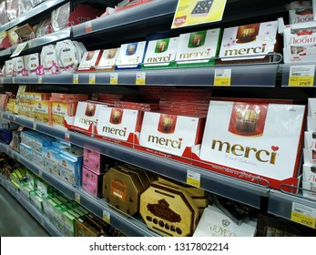 KEMEROVO, RUSSIA, FEBRUARY 14, 2019. A lot of boxes of various chocolate candies on the shelves are sold in a hypermarket Lenta