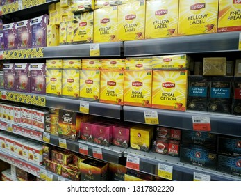 KEMEROVO, RUSSIA, FEBRUARY 14, 2019. A lot of boxes of various tea on the shelves are sold in a hypermarket Lenta