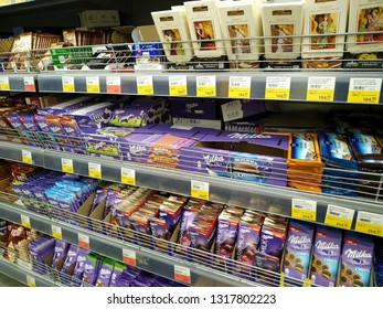 KEMEROVO, RUSSIA, FEBRUARY 14, 2019. A lot of various chocolate on the shelves are sold in a hypermarket Lenta