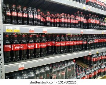 KEMEROVO, RUSSIA, FEBRUARY 14, 2019. Plastic bottles of Coca Cola on the shelves are sold in a hypermarket Lenta