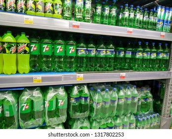 KEMEROVO, RUSSIA, FEBRUARY 14, 2019. Plastic bottles of Sprite and others cool drinks on the shelves are sold in a hypermarket Lenta