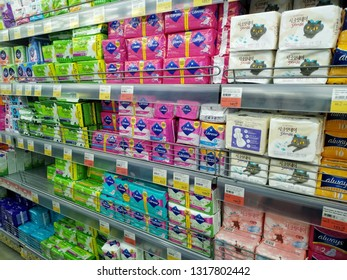 KEMEROVO, RUSSIA, FEBRUARY 14, 2019. Various sanitary napkins for women on the shelves are sold in a hypermarket Lenta