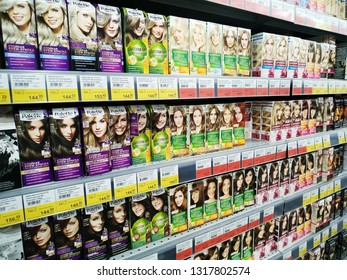 KEMEROVO, RUSSIA, FEBRUARY 14, 2019. Various hair dye on the shelves are sold in a supermarket Lenta