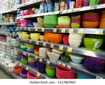 KEMEROVO, RUSSIA, FEBRUARY 14, 2019. Shelves with various plastic dishware in a hypermarket Lenta