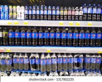 KEMEROVO, RUSSIA, FEBRUARY 18, 2019. Shelves with rows of bottles of Pepsi Cola in a hypermarket Lenta
