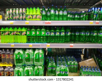KEMEROVO, RUSSIA, FEBRUARY 18, 2019. Shelves with rows of bottles of cool drinks such as Sprite and Seven Up in a hypermarket Lenta