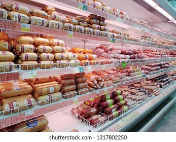 KEMEROVO, RUSSIA, FEBRUARY 18, 2019. Shelves with large assortment of various sausage in a hypermarket Lenta