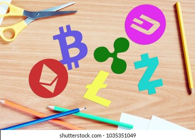 KEMEROVO RUSSIA  FEBRUARY 25 2018. Different crypto-currencies. Multicolored cryptocurrency symbols lie on a wooden desk