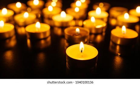 Kemerovo, Russia, fire in the mall, burning candles. Shallow depth of field. Many candles burning at night. Candles background. Many candle flames glowing on dark background. Close-up. Free space