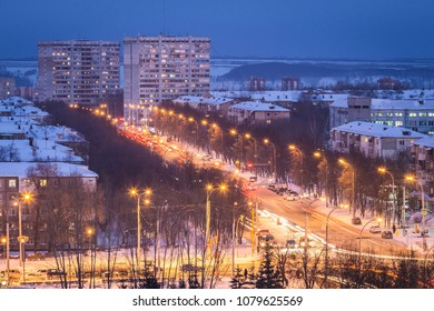 Kemerovo, Russia - January 30, 2018 - aerial winter view of prefabricated multistorey residential buildings at nights; illuminated streets with cars