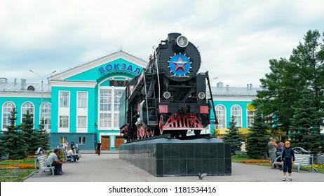 "Kemerovo, Russia - July 21, 2018: Monument to Russian locomotive L-3238 near railway station ""Kemerovo-passenger""."