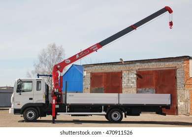 KEMEROVO, RUSSIA - MAY 14, 2015: great white truck crane standing on a construction site