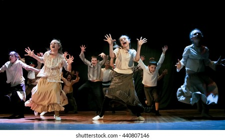Kemerovo, Theatre Festival, 21 November 2015 - Children on stage dancing the dance from a robbers story Capek