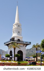 KEMER,TURKEY - JUNE 23,2012:a Central clock and a taxi on the square in the town of Kemer.Turkey