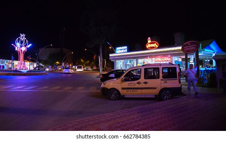 KEMER/TURKEY - MAY 7 2017: Streets and buildings of Kemer resort town at night. Turkey. Asia Minor