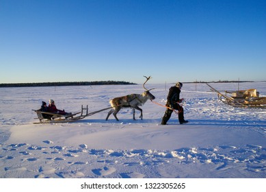Kemi Snowcastle, Finland - circa January 2007: Small children in sleigh pulled by reindeer in snowy countryside of Finland. Documentary editorial.
