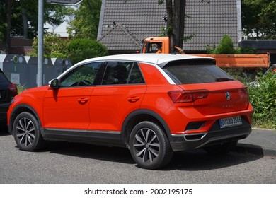 Kempen,Germany-June 17,2021: Red Volkswagen T-Roc with white roof parked in Kempen, is a subcompact crossover SUV (B-segment) manufactured by German automaker Volkswagen from 2017-present
