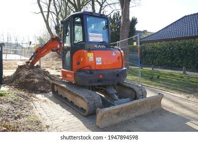 Kempen,Germany-March 30,2021: Kubota U55-4 Mini Excavator Diggers with steel tracks in Kempen.