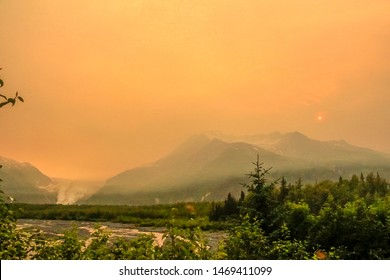 KENAI PENINSULA, ALASKA/USA- 07/04/2019: view of wildfire's smoke in the Kenai Mountains of Alaska in the Kenai Fjords National Park