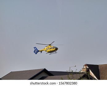 Kendal, Cumbria, UK - April 17 2019: Yellow and blue North West Air Ambulance in the air just after take off