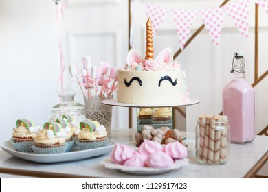 kendi bar on children's birthday. cake with unicorn and sweets, ornaments in gentle pastel tones