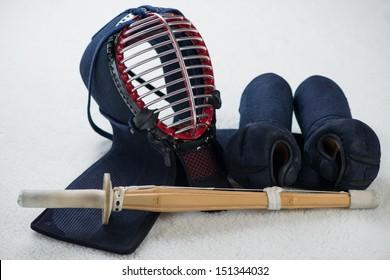 Kendo equipment: men, kote and shinai, studio shot