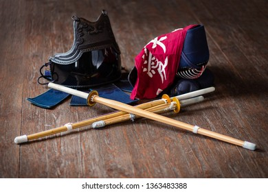 Kendo gloves, helmet and bamboo sword on a wooden surface. Kendo armor.